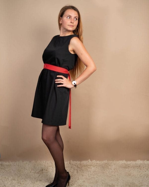 Petite friendly black reversible dress with red belt